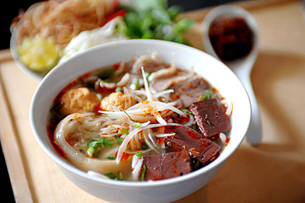 "The major ingredient to cook ""bun bo Hue"" is beef and pork."