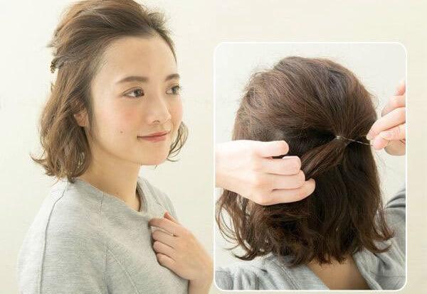 Tóc dài buộc nửa đầu.