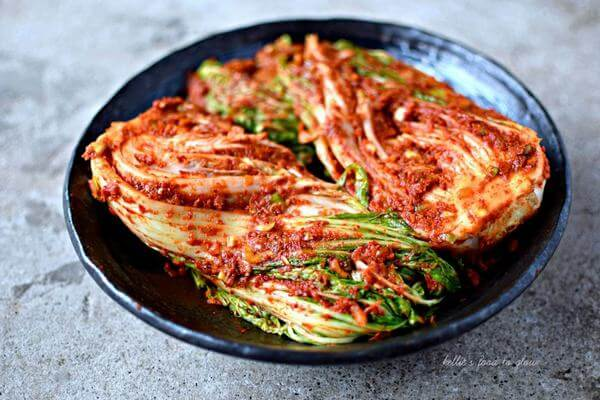 "Kimchi (also spelled ""kimchee"") is a traditional Korean"