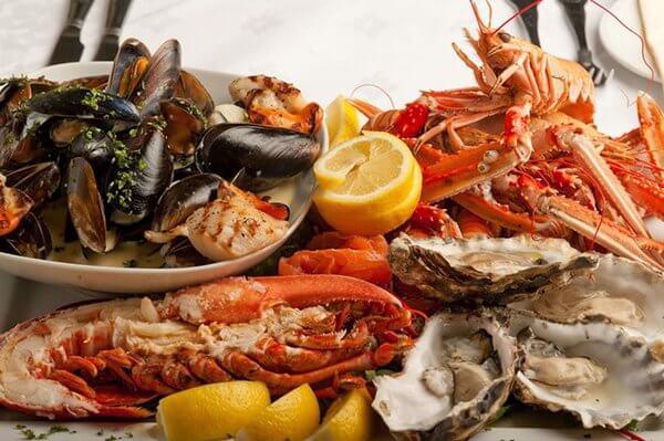 bổ sung thêm các loại hải sản - Đau dạ dày khi mang thai 3 tháng cuối có nguy hiểm không
